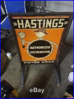 Hastings Piston Rings advertising tin porcelain gas/oil sidewalk sign