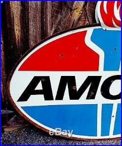 Original Amoco Sign in the ring with Flames. 74inx45in Porcelain. Double sided